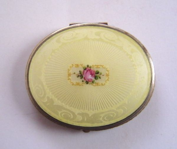 Bliss Bros Co. oval yellow enamel powder compact